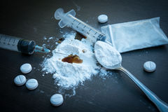 Drug syringe and cooked heroin on spoon. Drug Stock Images