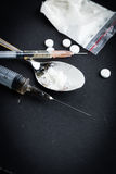 Drug syringe and cooked heroin. On spoon royalty free stock photography