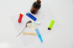 Drug syringe and cooked heroin on spoon Royalty Free Stock Photos