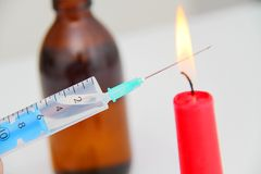 Drug syringe and cooked heroin on spoon Stock Photo