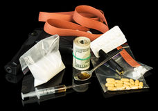 Drug syringe and heroin. With pills over money Stock Photo