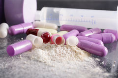 Drug syringe and pills with cocaine Royalty Free Stock Photos