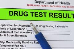 Drug test result. Macro shot of Drug test result form with blue pen stock photo