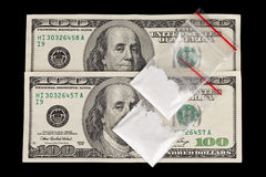 Drug Trafficking. Two 100 dollar bills with 2 bags of white powder on them royalty free stock photo