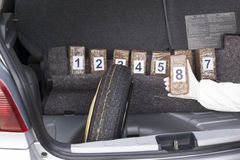 Drug trafficking. Drug smuggled in a car trunk Stock Image