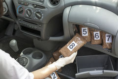 Drug trafficking. Drug smuggling. Drug packages smuggled in a car's cabin Stock Photos