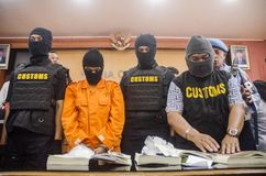 DRUG TRAFICKER. A captured meth smuggler was publicized to the press by Indonesian Customs at Solo, Java, Indonesia. Illegal drug trader and trafickers face Royalty Free Stock Photography