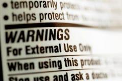 Drug warning label. Close up of drug warning label Stock Images