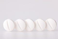 Drug white tablet Royalty Free Stock Photos