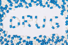 Drug word text made of blue tablets, pills and capsules Stock Photo