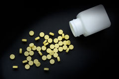 Drug and bottle. Drug is yellow color ,Out of bottle Royalty Free Stock Photos