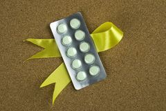 Drug on yellow ribbon Royalty Free Stock Images
