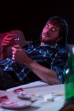 Drugged man smoking a joint Stock Images