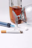 Drugs. Addicted in tablets alcohol syringe and cigarette Stock Photo