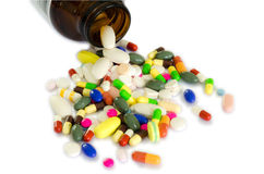 Drugs from the bottle (isolate). Many type of drugs poring from the bottle woth isolation background Stock Photos