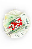 Drugs - capsules on banknotes Royalty Free Stock Image