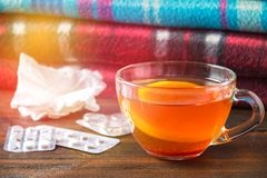 Drugs for colds - pills, spray. Folk remedies - lemon, tea, raspberry jam. Thermometer, handkerchiefs. Treatment of illness, influ. Drugs for colds - pills Stock Photography