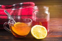 Drugs for colds - pills, spray. Folk remedies - lemon, tea, raspberry jam. Thermometer, handkerchiefs. Treatment of illness, influ. Drugs for colds - pills Stock Photo