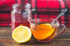 Drugs for colds - pills, spray. Folk remedies - lemon, tea, raspberry jam. Thermometer, handkerchiefs. Treatment of illness, influ. Drugs for colds - pills Royalty Free Stock Photography
