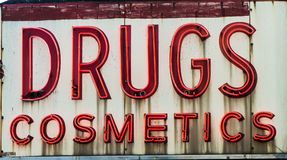 Drugs and cosmetics neon sign Royalty Free Stock Images