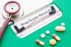 Drugs and drug screen result form. Royalty Free Stock Photography