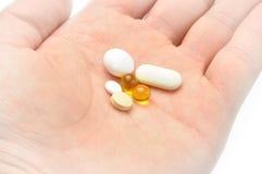 Drugs in een hand Stock Afbeeldingen