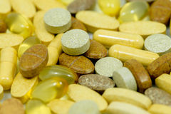 Drugs and food supplements pills Stock Image