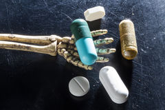 Drugs on hand bones. Tablet Drugs on hand bones royalty free stock photos