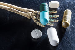 Drugs on hand bones. Tablet Drugs on hand bones royalty free stock image