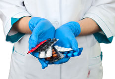 Drugs in the hands of a doctor Stock Images