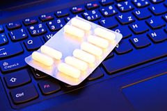 Drugs on the keyboard Stock Photos