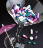 Drugs in a martini glass Royalty Free Stock Photo