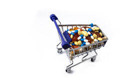 Drugs and medicine in a shopping cart Royalty Free Stock Image
