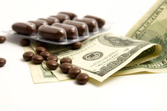 Drugs money. On a white background Royalty Free Stock Photography