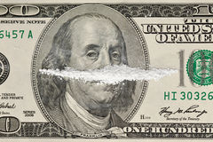 Drugs and Money. A 100 dollar bill with a line of white powder and on it Stock Images