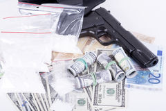 Drugs,money,cocaine and gun Royalty Free Stock Photos