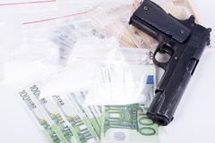 Drugs,money,cocaine and gun Stock Image