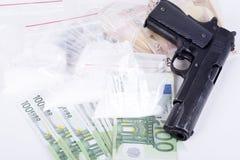 Drugs,money,cocaine and gun Stock Image
