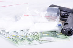 Drugs,money,cocaine and gun Royalty Free Stock Images