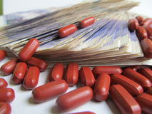Drugs Money Health Finance 4. Thousands of pounds of twenty pound notes and drugs and tablets Stock Image