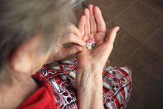 Drugs in old woman's hands Royalty Free Stock Photo