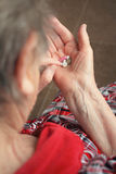 Drugs in old woman's hands Stock Images