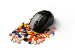Drugs Online. Mouse and Pills Royalty Free Stock Photo