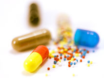 Drugs out of the capsule Stock Photography