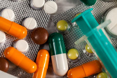 Drugs, pills and medication on table in close up photo Royalty Free Stock Photography