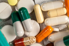 Drugs, pills and medication on table in close up photo Royalty Free Stock Images