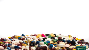 Drugs and pills. Pile of pills in front of white background Royalty Free Stock Photos