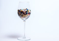 Drugs and pills. Drugs and pilles in a wine glass Stock Photos