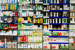 Drugs for sale in a pharmacy. Shelves of different drugs for sale in a pharmacy store Stock Photography