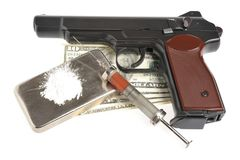 Drugs, syrine with blood, pistol and money. Drugs, syrine with blood, pistol, money isolated Stock Photography